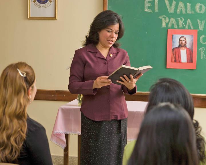 Mormon woman teaching at Church.