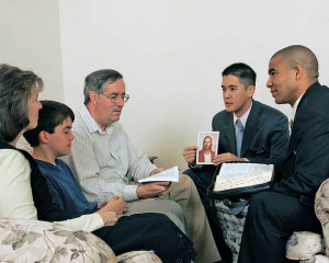 Mormon missionaries teaching in the home