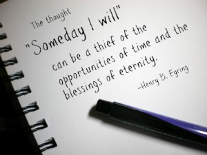 Notepad and pen with a quote about motivation from Henry Eyring.