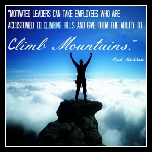 Man at top of mountain with clouds below, with quote about leaders.