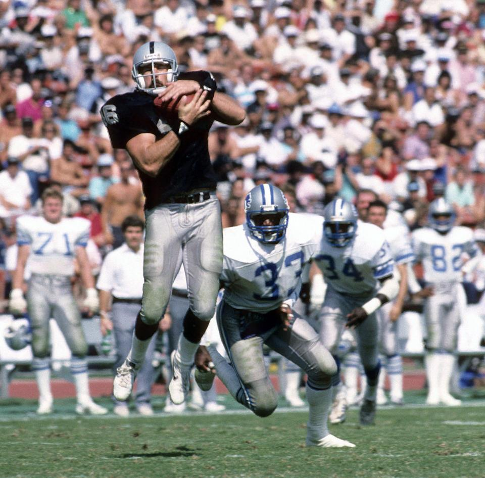 Todd Christensen catches a pass for the Raiders.