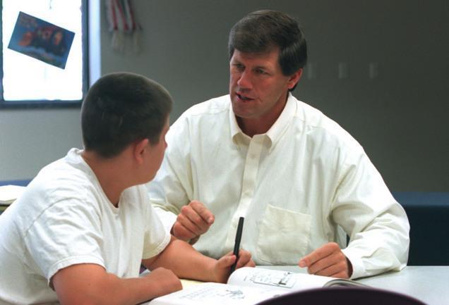 Todd Christensen teaching a young man.