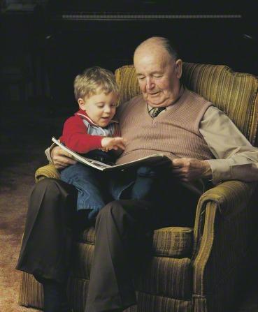 Boy and Granpa Reading Book Mormon